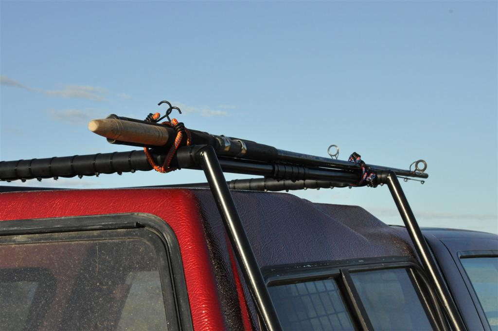 Fishing rods on the roof rack for Roof rack fishing rod holder