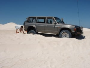 A four wheel drive stuck in the sand