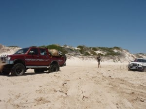 Pulling out a Prado on the beach