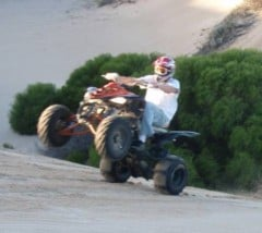 Riding a motorbike in the dunes