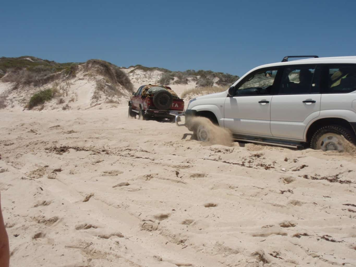 Pulling a car out of soft sand