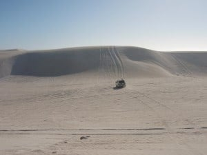 Trying to drive up a dune