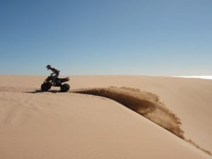 Riding a quad in the dunes