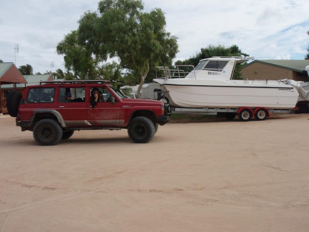 Bayview Caravan Park chalets and a big boat