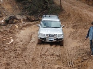 A 100 Series Landcruiser in the mud