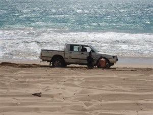 Car bogged on the beach