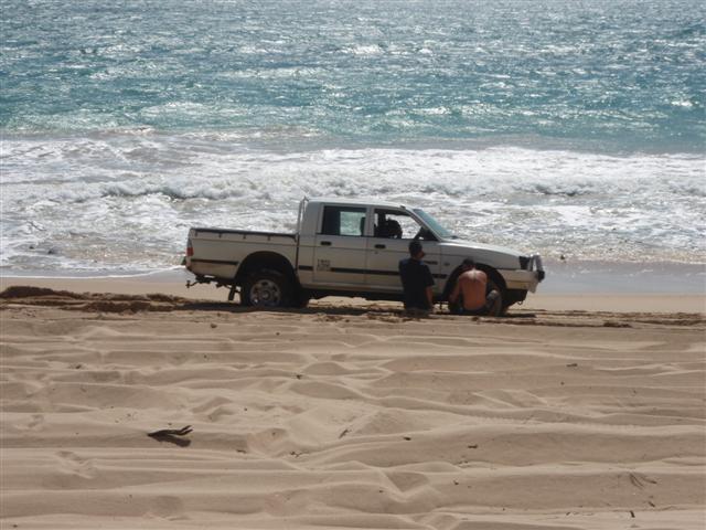Car bogged on the beach