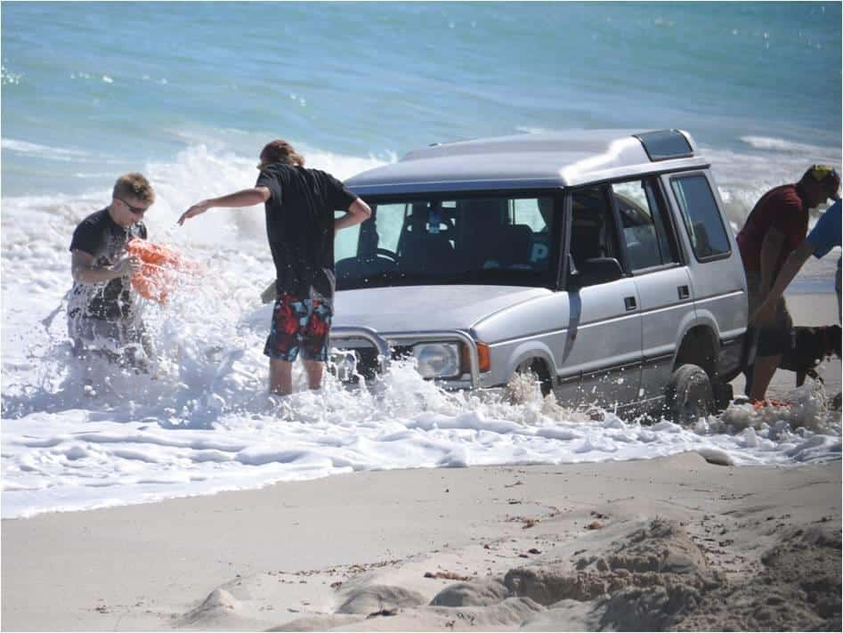 Badly bogged Land Rover