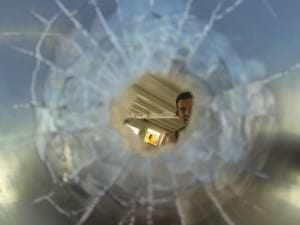 Bullet hole in the window of the boat